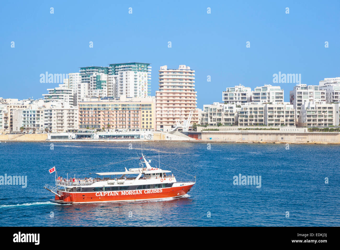 Sliema Skyline Marsamxett Harbour and Tourist boat Valletta Malta EU Europe - Stock Image