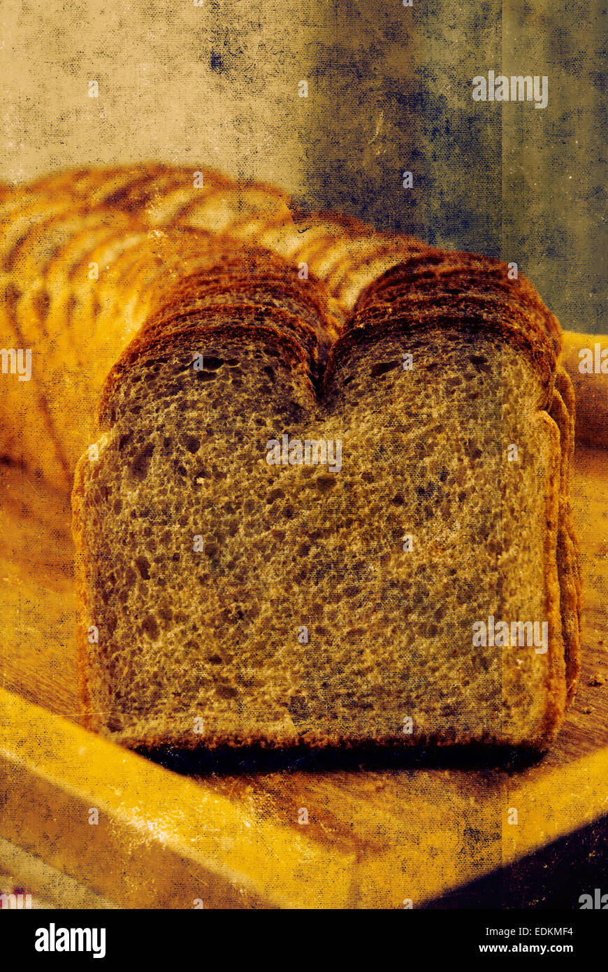 A worn-looking photo of a loaf of bread or toast.  Weathered or grungy effect applied to photo. - Stock Image