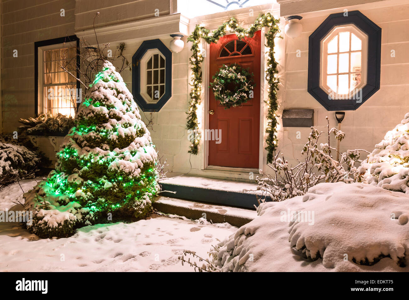 the front door of a snow covered family home decorated for christmas stock image - Front Door Entrance Christmas Decoration