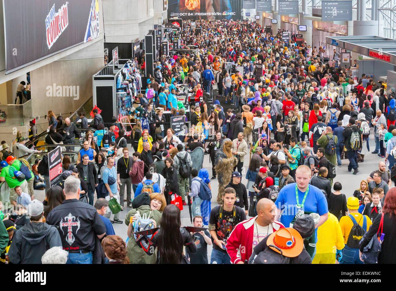 A crowd of visitors and fans to the New York ComicCon comic book and movie convention. - Stock Image