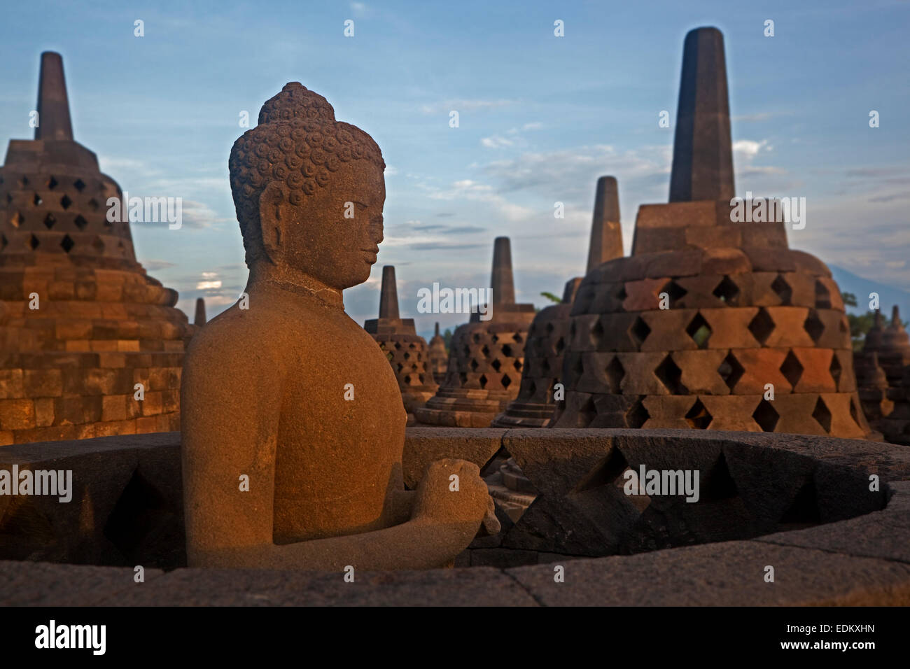 Buddha statue and stupas at Borobudur / Barabudur, 9th-century Mahayana Buddhist Temple in Magelang, Central Java, - Stock Image