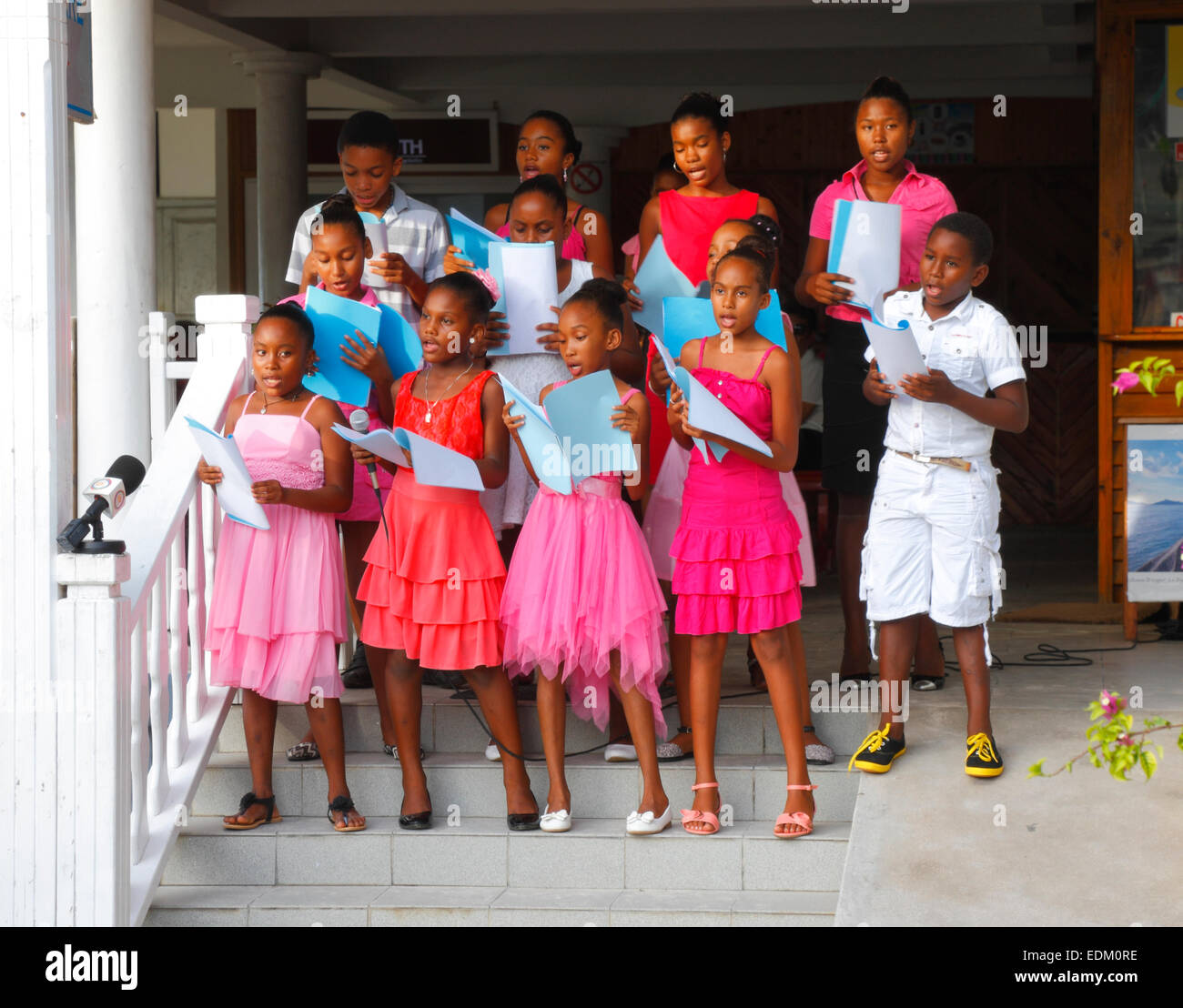 Seychelles island, La Digue.  Children singing Christmas songs. - Stock Image