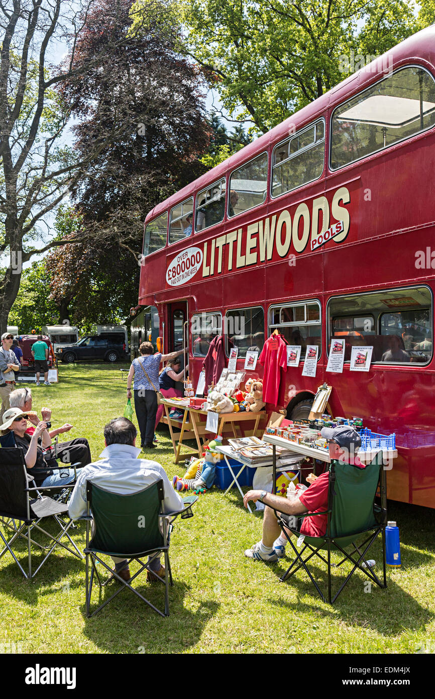 People with vintage double decker bus from 1964 with Littlewoods Pools advert, Steam Rally, Abergavenny, Wales, - Stock Image