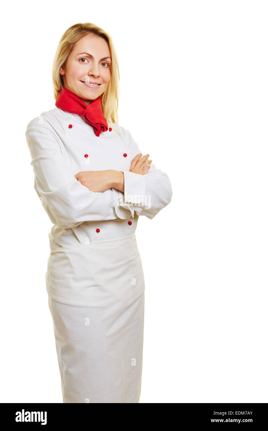 Young smiling woman as chef cook in white workwear - Stock Image