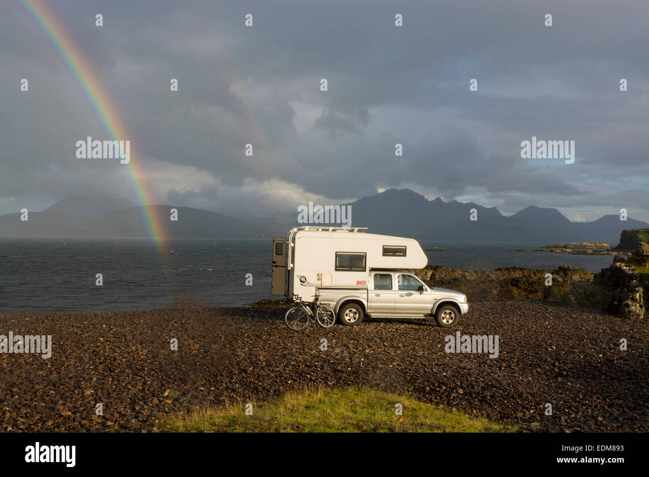 camper van and rainbow tokavaig skye - Stock Image