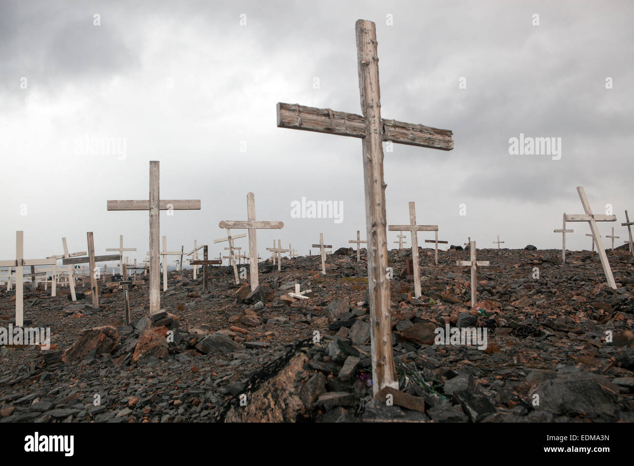 A cemetery in the town of Ittoqqortoormiit, East Greenland. On this northern latitude, the Earth has no soil. - Stock Image