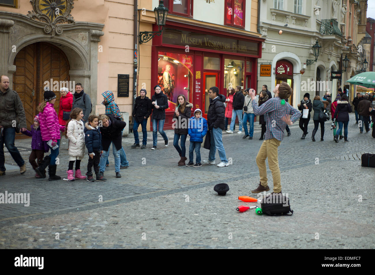 A young juggler busking in the Old town Square Prague - Stock Image