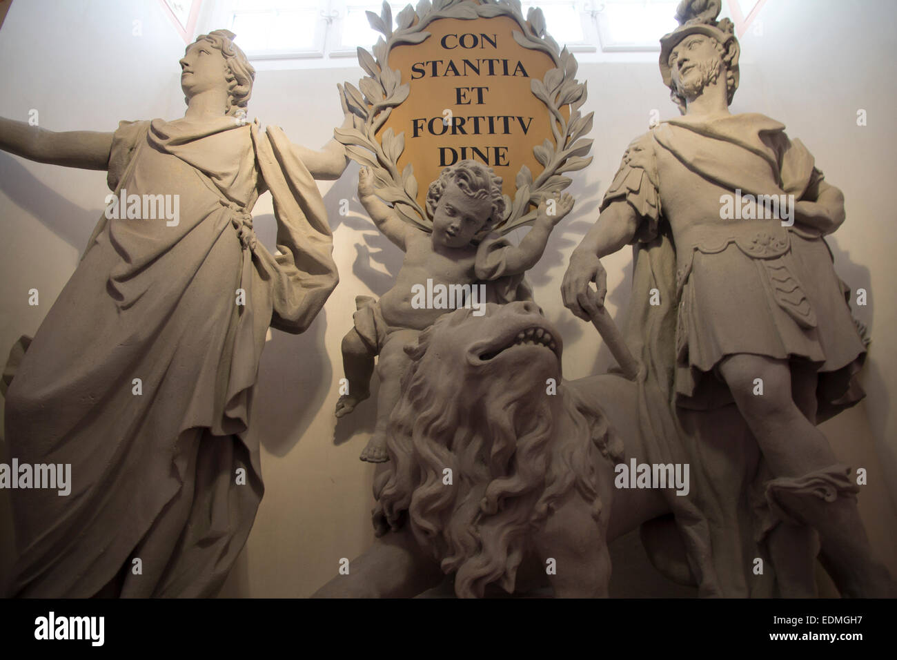 Allegorical statuary on Imperial Staircase at Melk Abbey. Inscription 'constantia et fortitudine' (perseverance - Stock Image