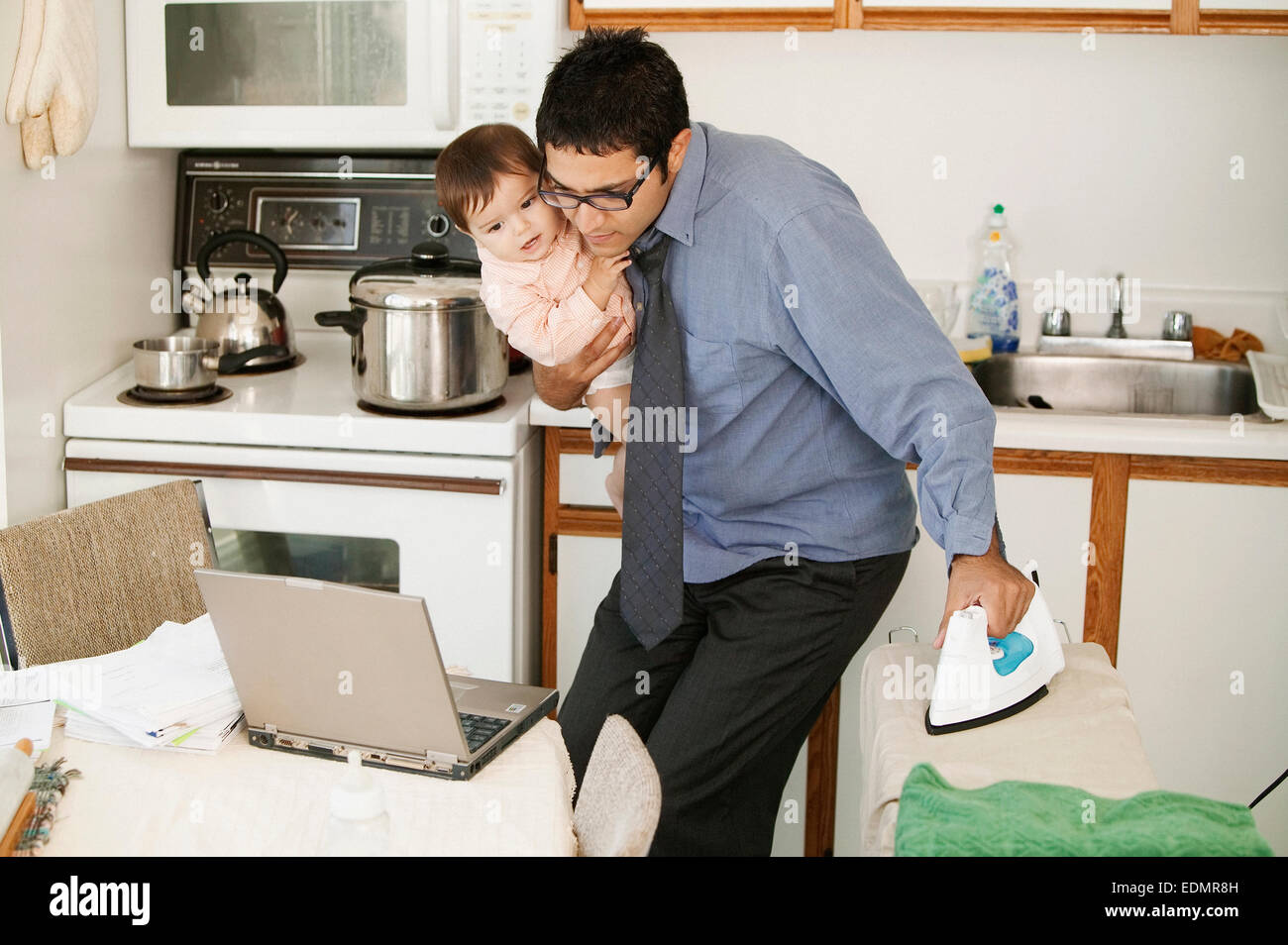 home office multitasking. Father Multitasking At Home Office