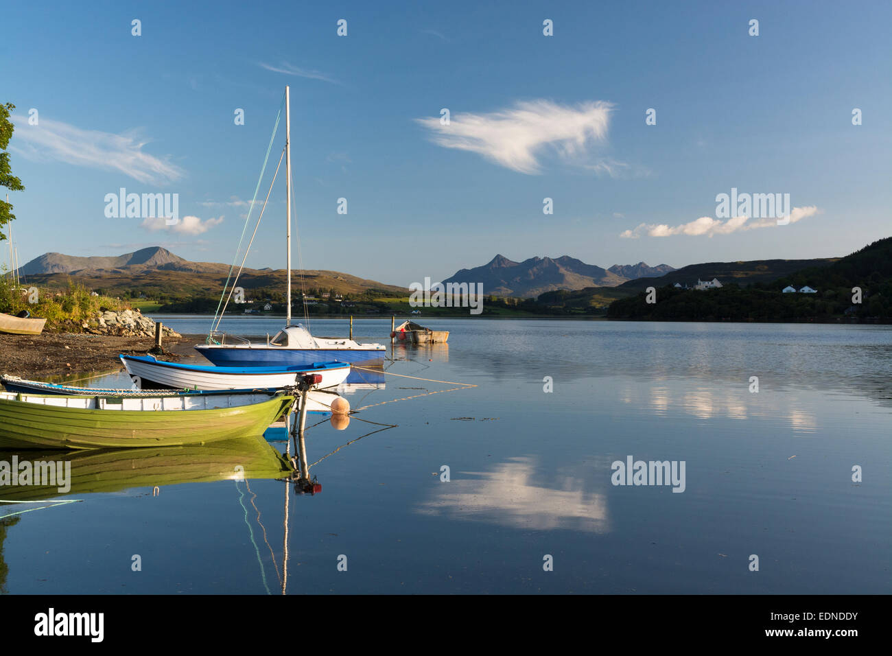 portree dinghy mooring with tranquil reflections isle of skye - Stock Image