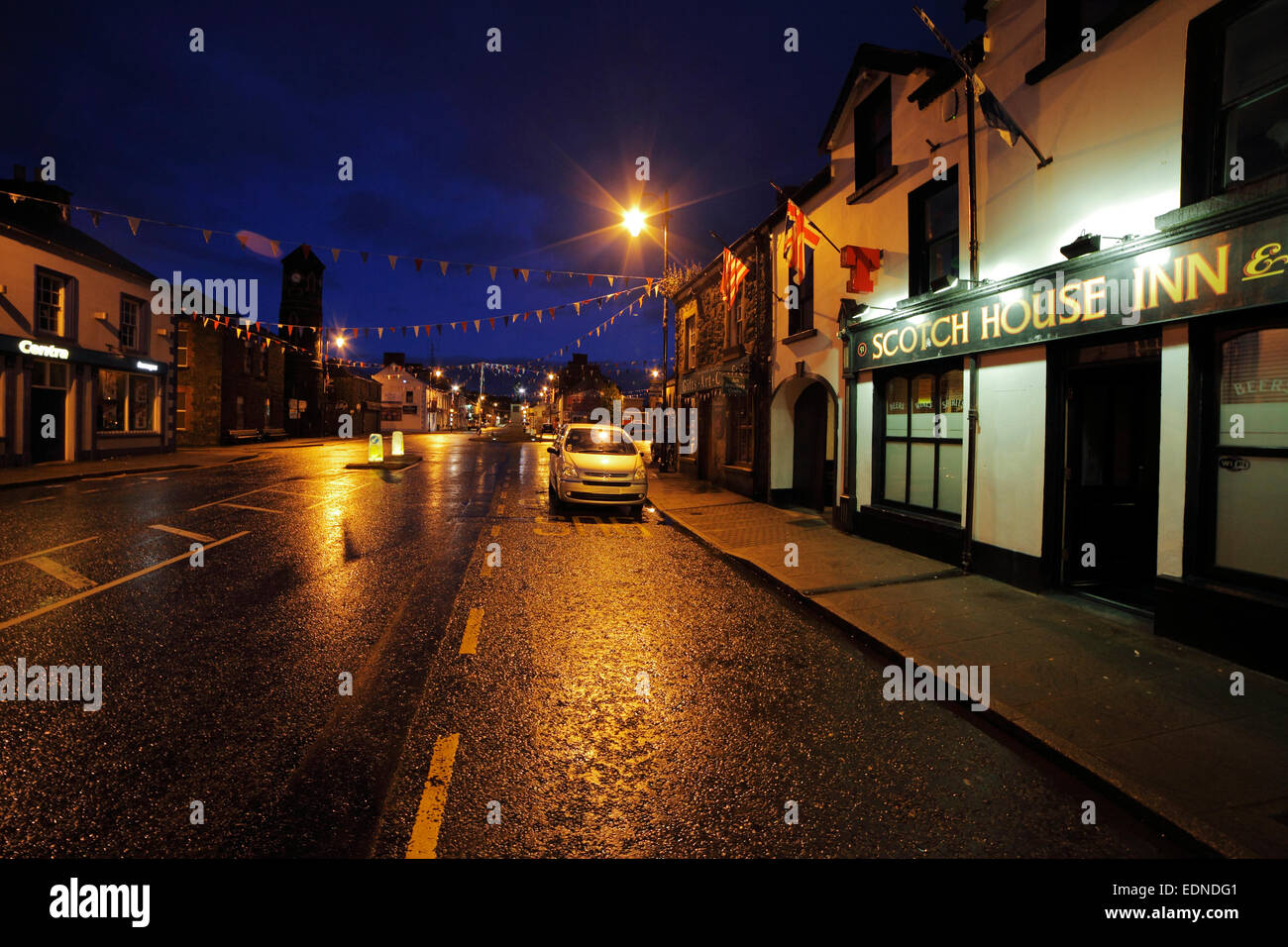 Main Street in Bushmills in Northern Ireland at night - Stock Image