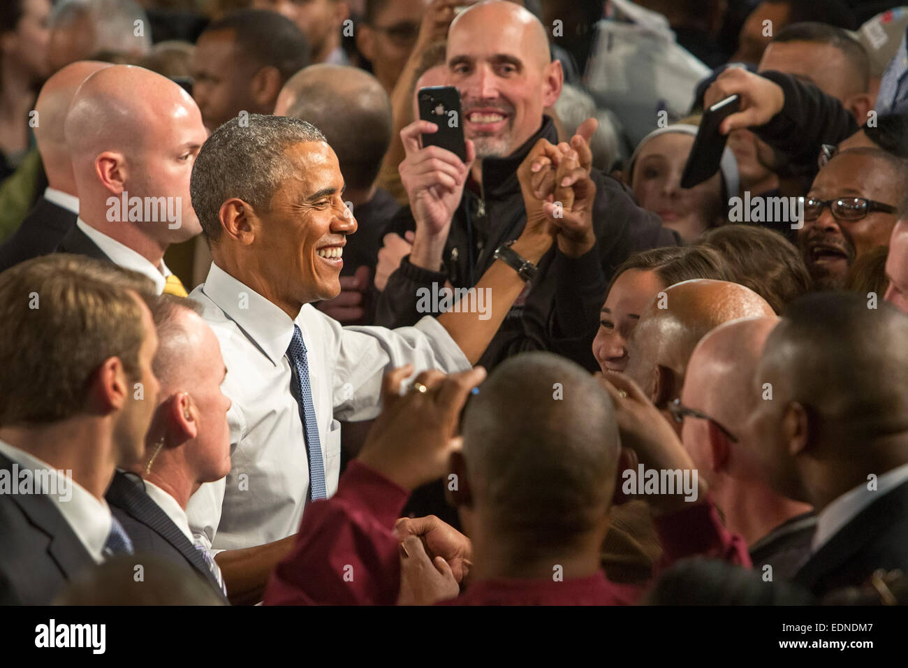 Wayne, Michigan, USA. President Barack Obama shakes hands following a speech at Ford's Michigan Assembly Plant. - Stock Image