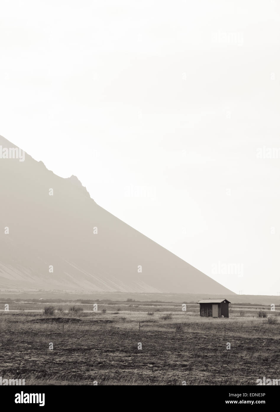 House and Mountain in Iceland - Stock Image