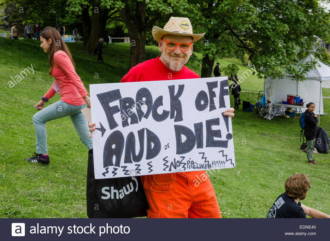 Protestor with sign, No Enbridge Pipeline Rally, May 10, 2014,  Sunset Beach, Vancouver, British Columbia, Canada - Stock Image