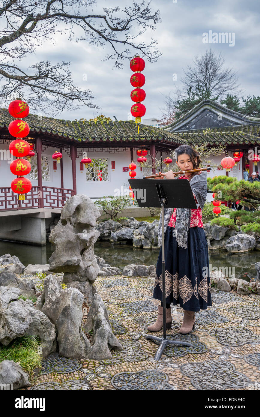 Chinese flute player, Dr Sun Yat Sen Garden, Chinese New Year Celebration, Vancouver, British Columbia, Canada - Stock Image