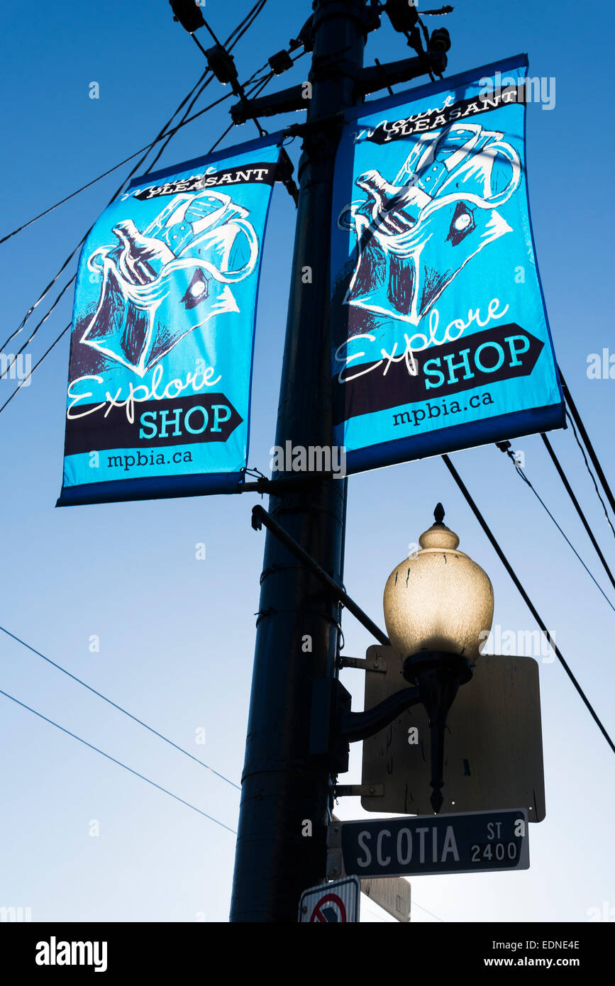 Street lamp banners, Mt. Pleasant neighbourhood, Vancouver, British Columbia, Canada - Stock Image