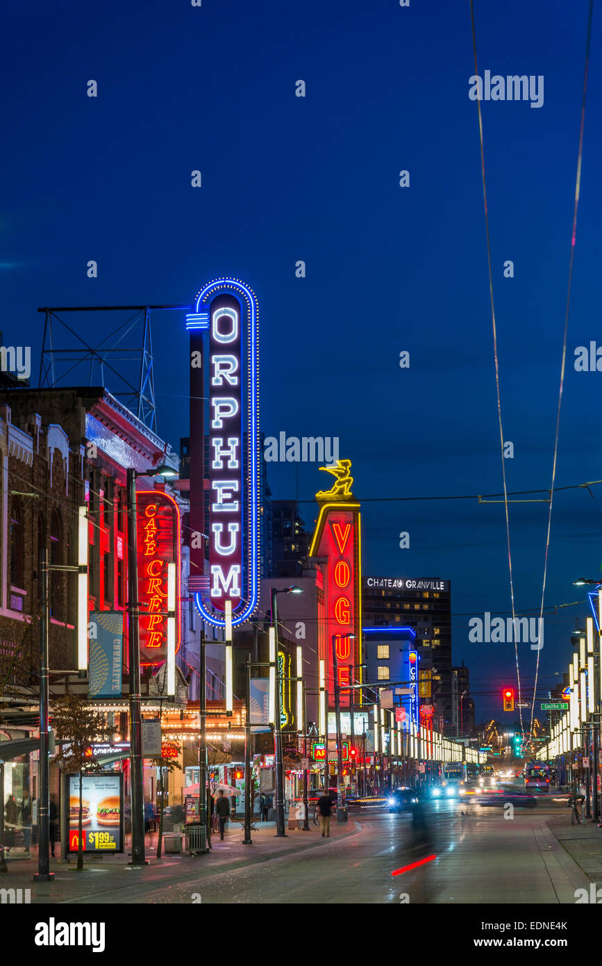 Orpheum and Vogue Theatre neon signs, Granville street at night, downtown, Vancouver, British Columbia, Canada - Stock Image