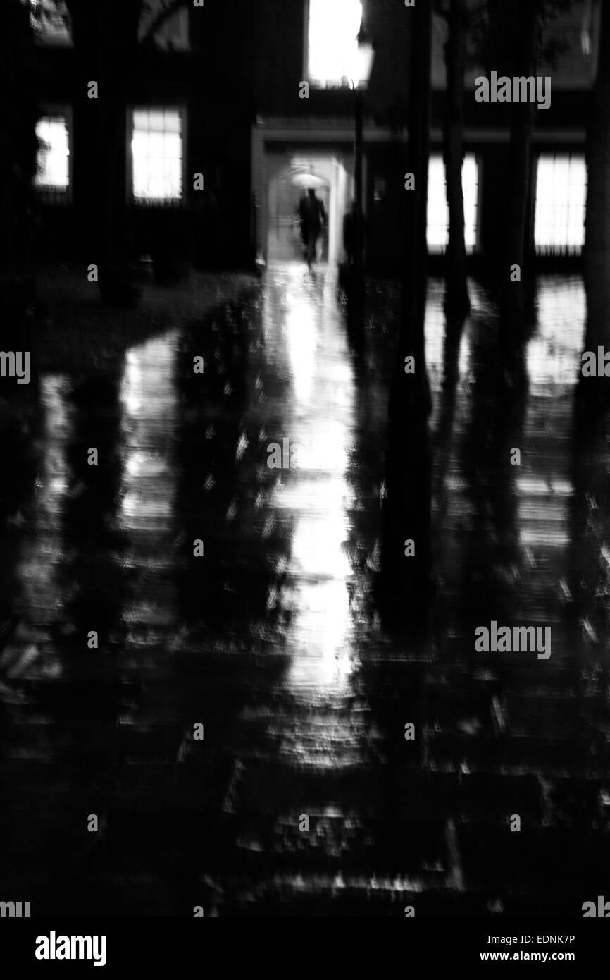 Blurred motion shot of wet and rainy night at Gray's Inn, Inns of Court, London, UK - Stock Image