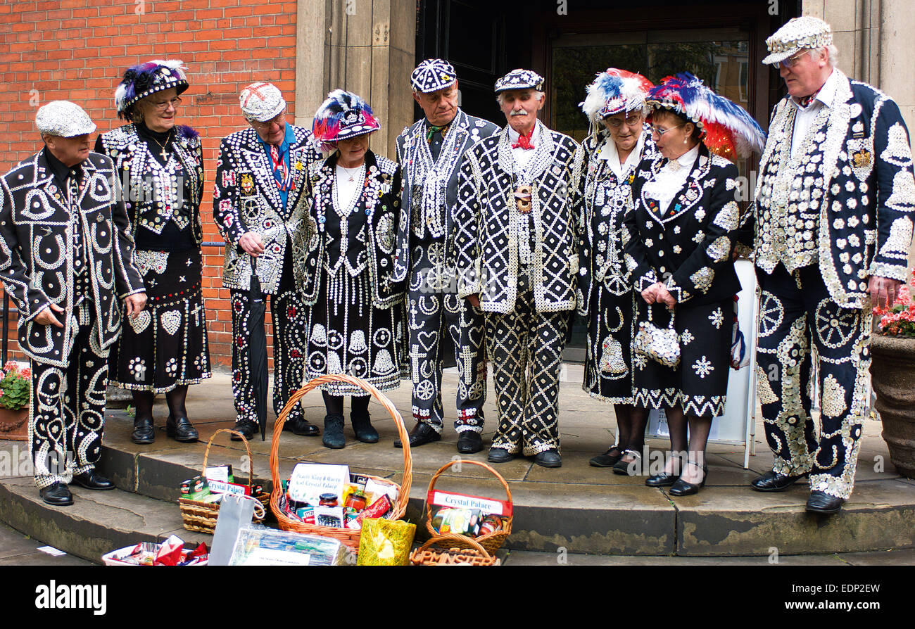 A large group of Pearly Kings and Queens from gather for the Harvest Festival Service at St. Paul's Church in Covent - Stock Image