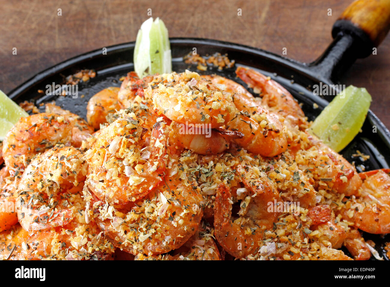 An frying pan with steaming hot prawns shot from above - Stock Image