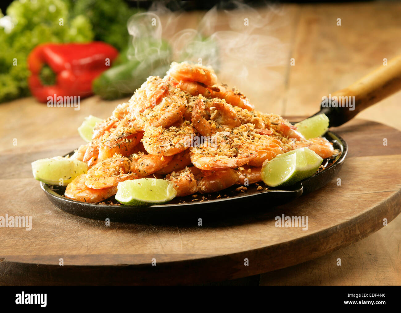 A frying pan with steaming hot prawns - Stock Image