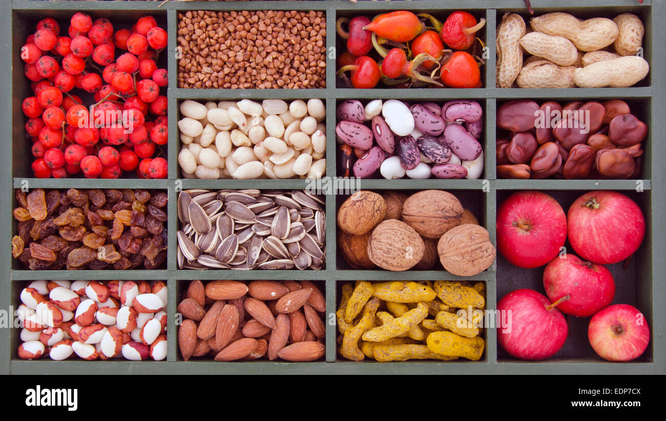 various vegetarian healthy fruits, seeds and dried food ingredient  in wooden box - Stock Image