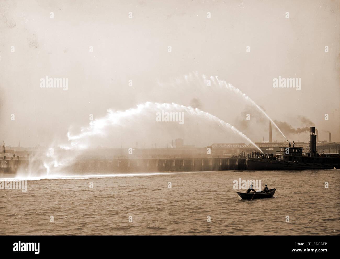 Fireboat 44 in action, Boston, Mass, Fireboats, Waterfronts, Rowboats, United States, Massachusetts, Boston, 1906 - Stock Image