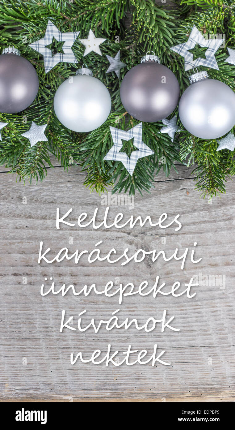 Hungarian christmas card with christmas baubles fir branches stars hungarian christmas card with christmas baubles fir branches stars and text merry christmas and a happy new year m4hsunfo