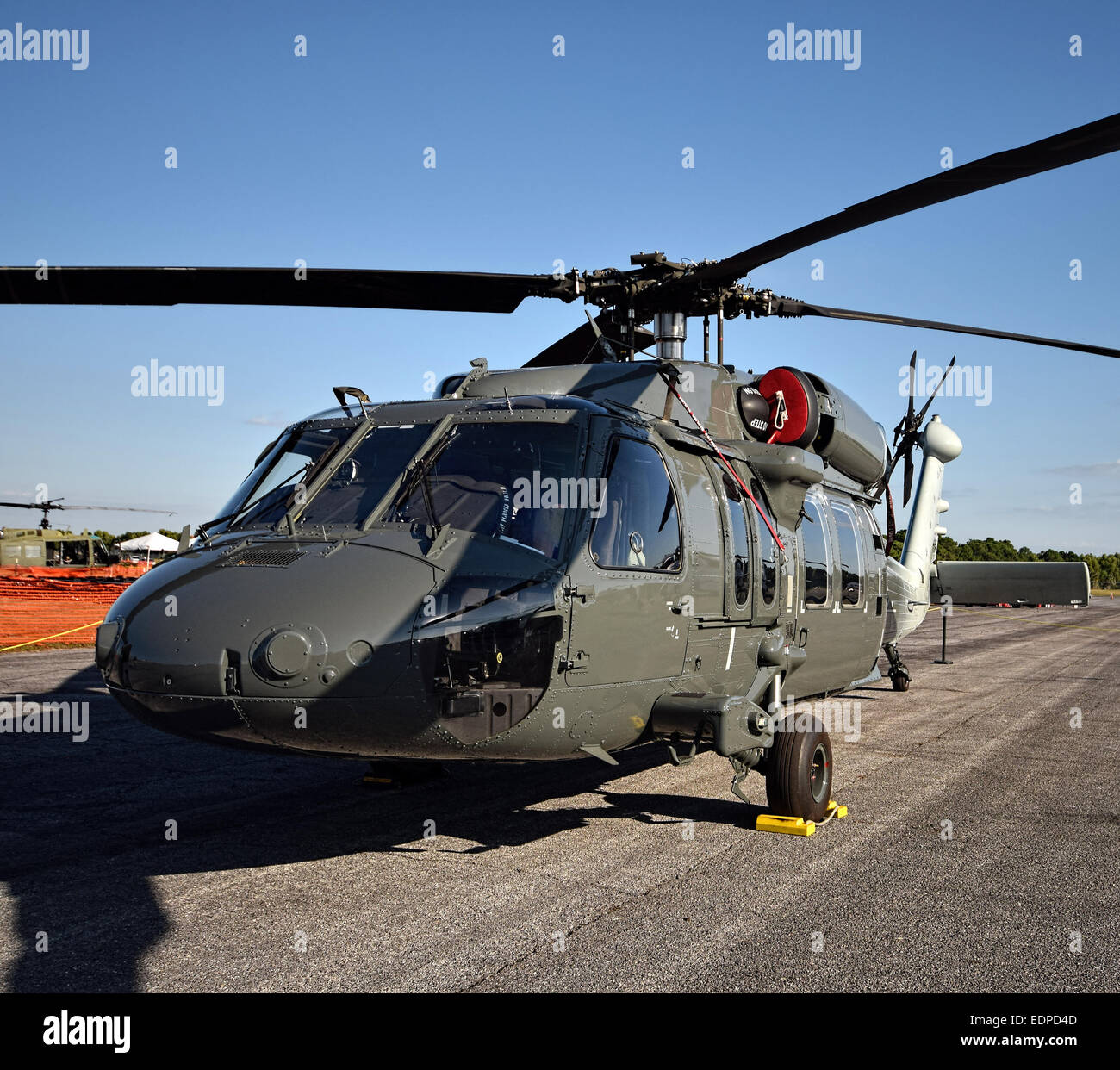 Modern military helicopter on the ground closeup - Stock Image