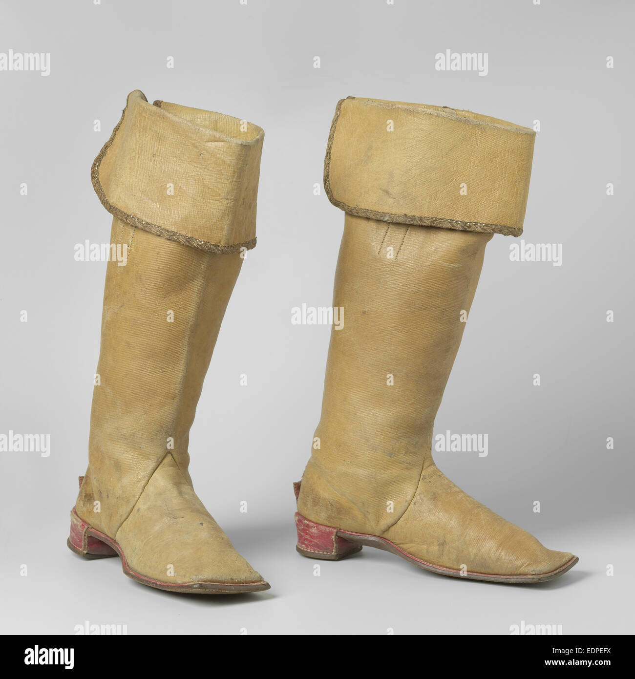 Knee High Boot from yellow cow leather, with gold braid deposed cover the top of the shaft, Anonymous, 1913 - Stock Image