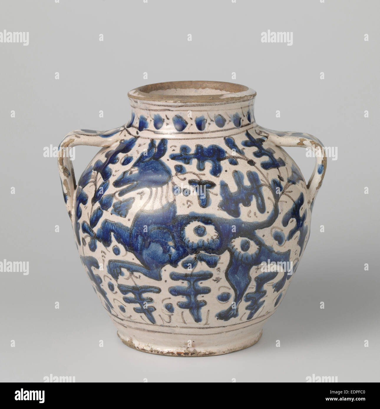 Can with two triangular ears. On both sides polychrome-painted with a running dog between stylized leaves - Stock Image