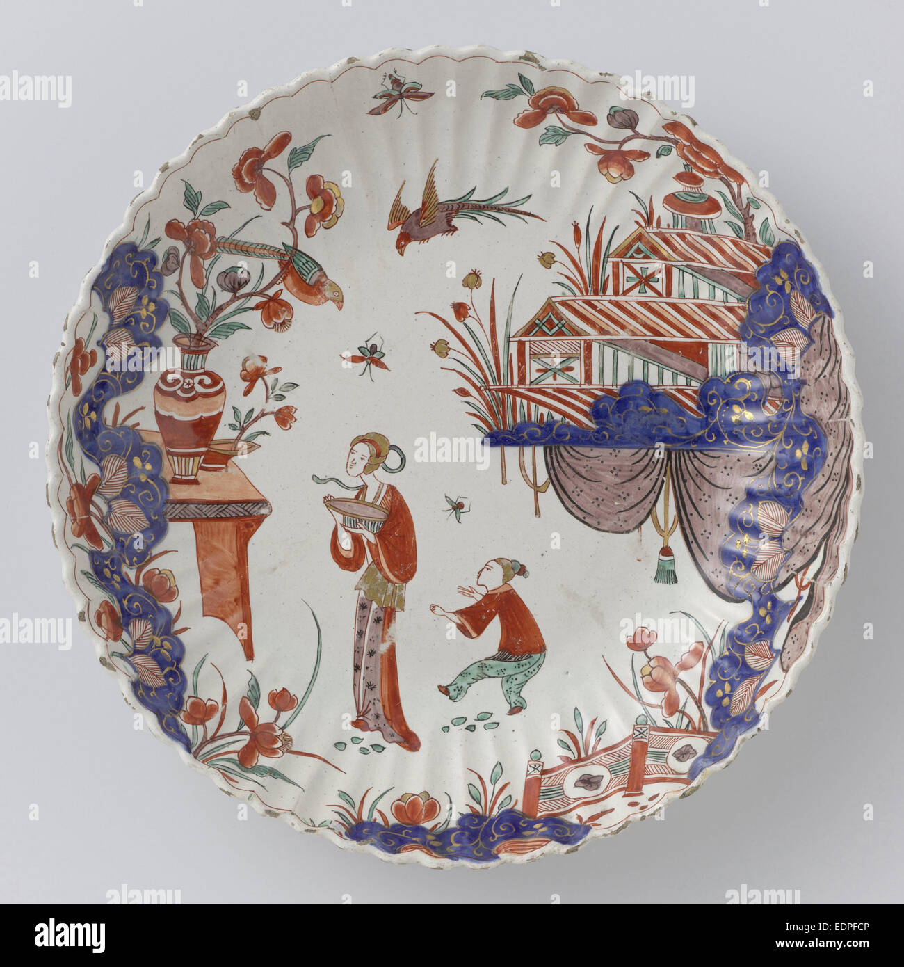 Round dish polychrome painted earthenware with Japanese decor - Stock Image