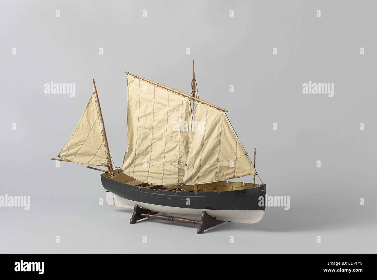 A one-masted sailing boat with a mainsail and jib rigged fore and aft, Anonymous, c. 1880 Stock Photo