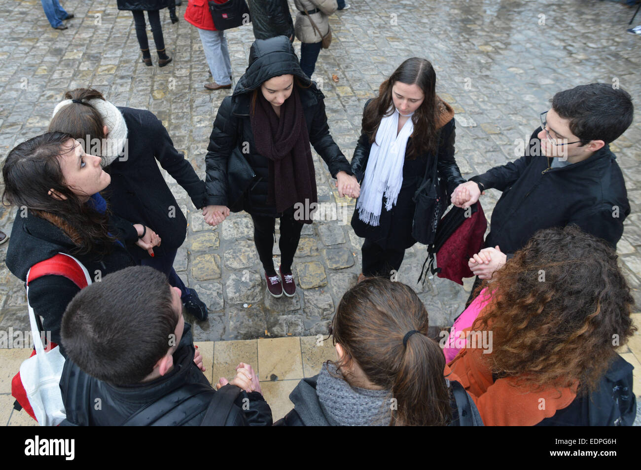Paris, France. 8th Jan, 2015. People gather for a minute of silence for the victims of the January 7 attack against Stock Photo
