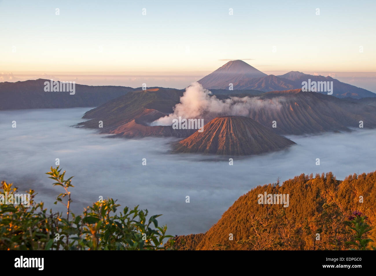 Sunrise over Mount Bromo / Gunung Bromo, active Indonasian volcano and part of the Tengger massif, East Java, Indonesia - Stock Image
