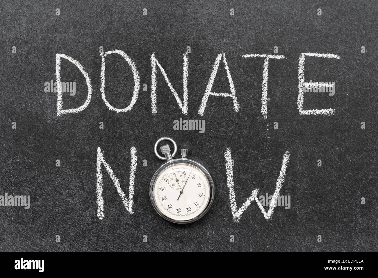 donate now concept handwritten on chalkboard with vintage precise stopwatch used instead of O - Stock Image