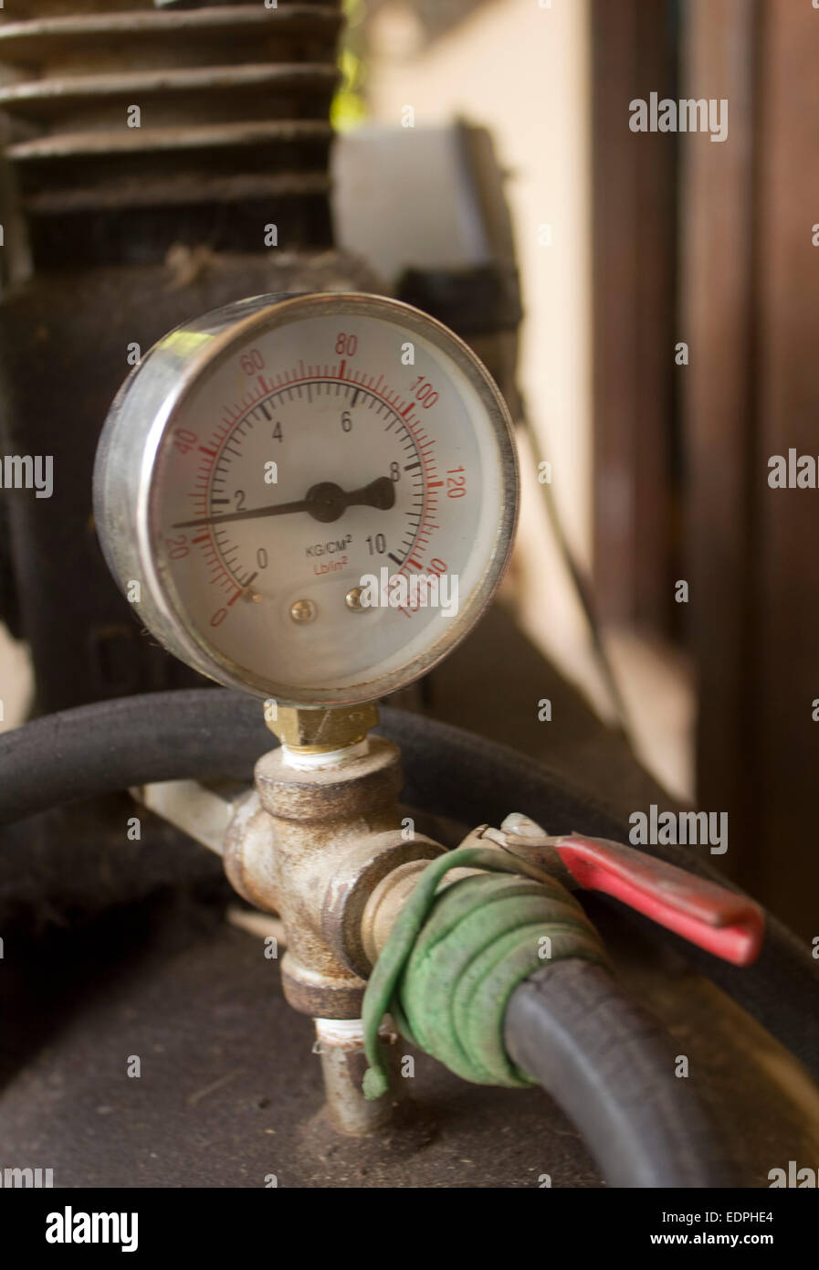 Rusty Air compressor meter - Stock Image