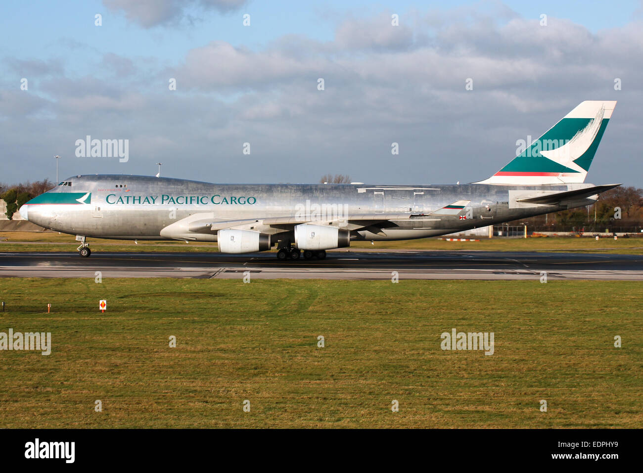 Cathay Pacific Cargo Boeing 747-400 accelerates down runway 23R at Manchester airport. - Stock Image