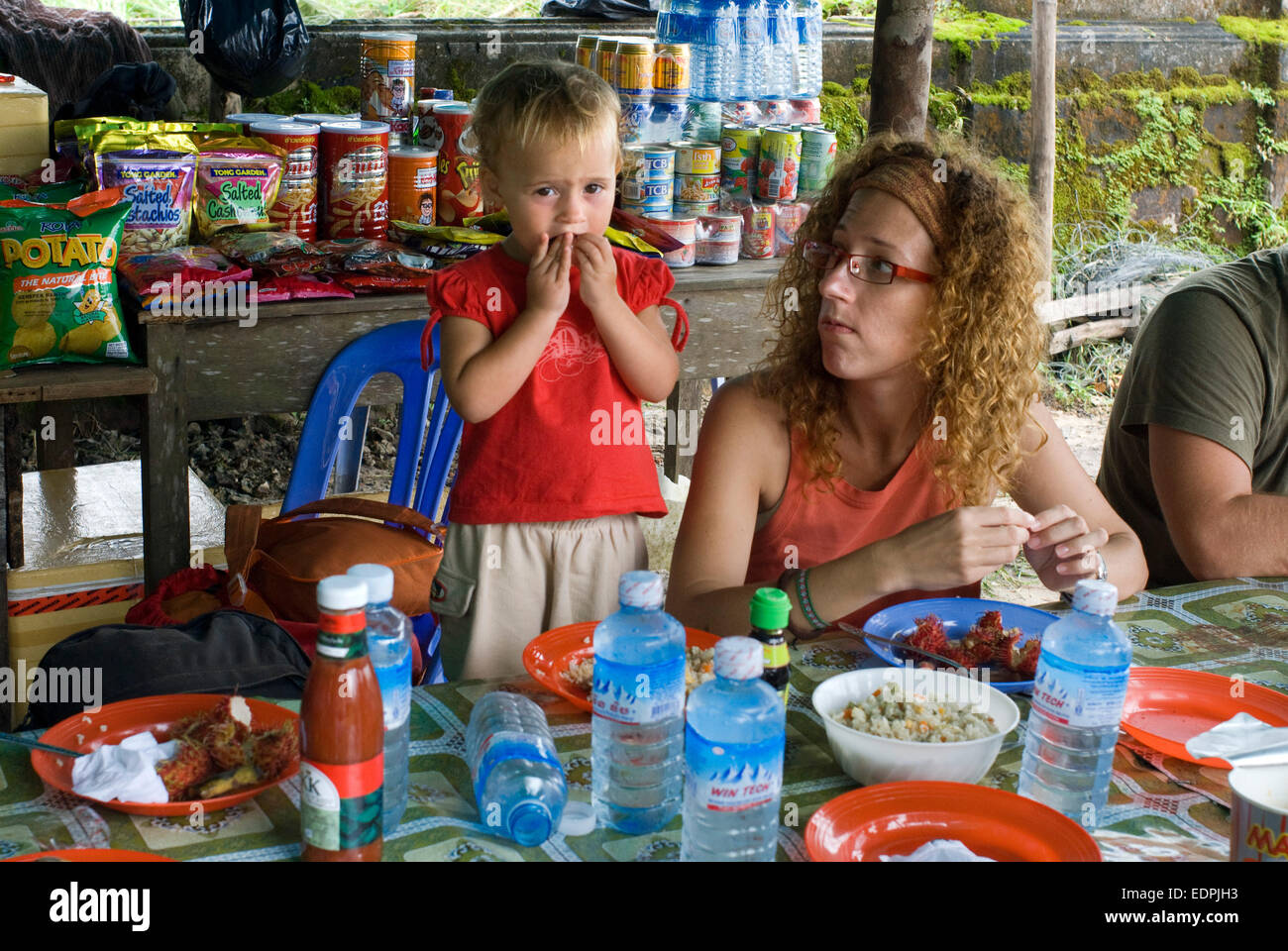 Bokor National Park. Cambodia. Travel with children's. Mother eating with her daughter. Privileged place to - Stock Image