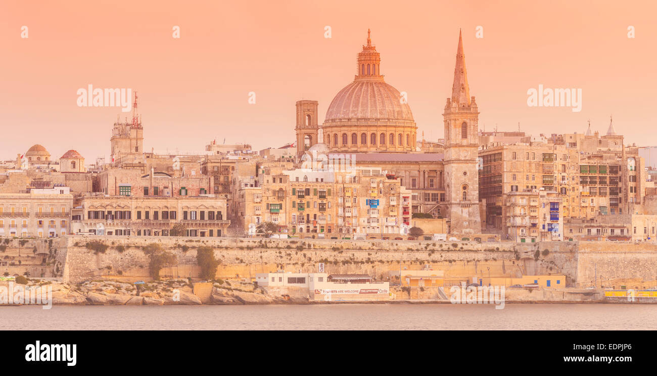 Valletta and Marsamxett Harbour with the Dome of the Carmelite Church and St Pauls Anglican Cathedral at Sunset - Stock Image