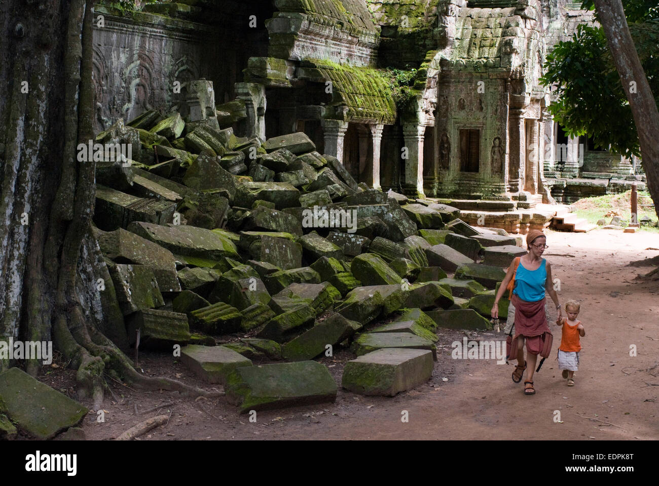 Travel with children's. Mother walking with her daughter. in Ta Prohm Temple. Cambodia. Asia. Ta Prohm's - Stock Image