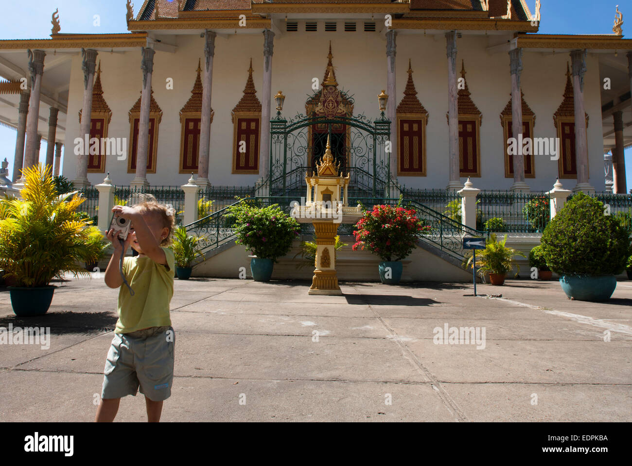 Child walking alone and take pictures in Royal Palace. Phnom Penh. The Royal Palace in Phnom Penh was constructed - Stock Image