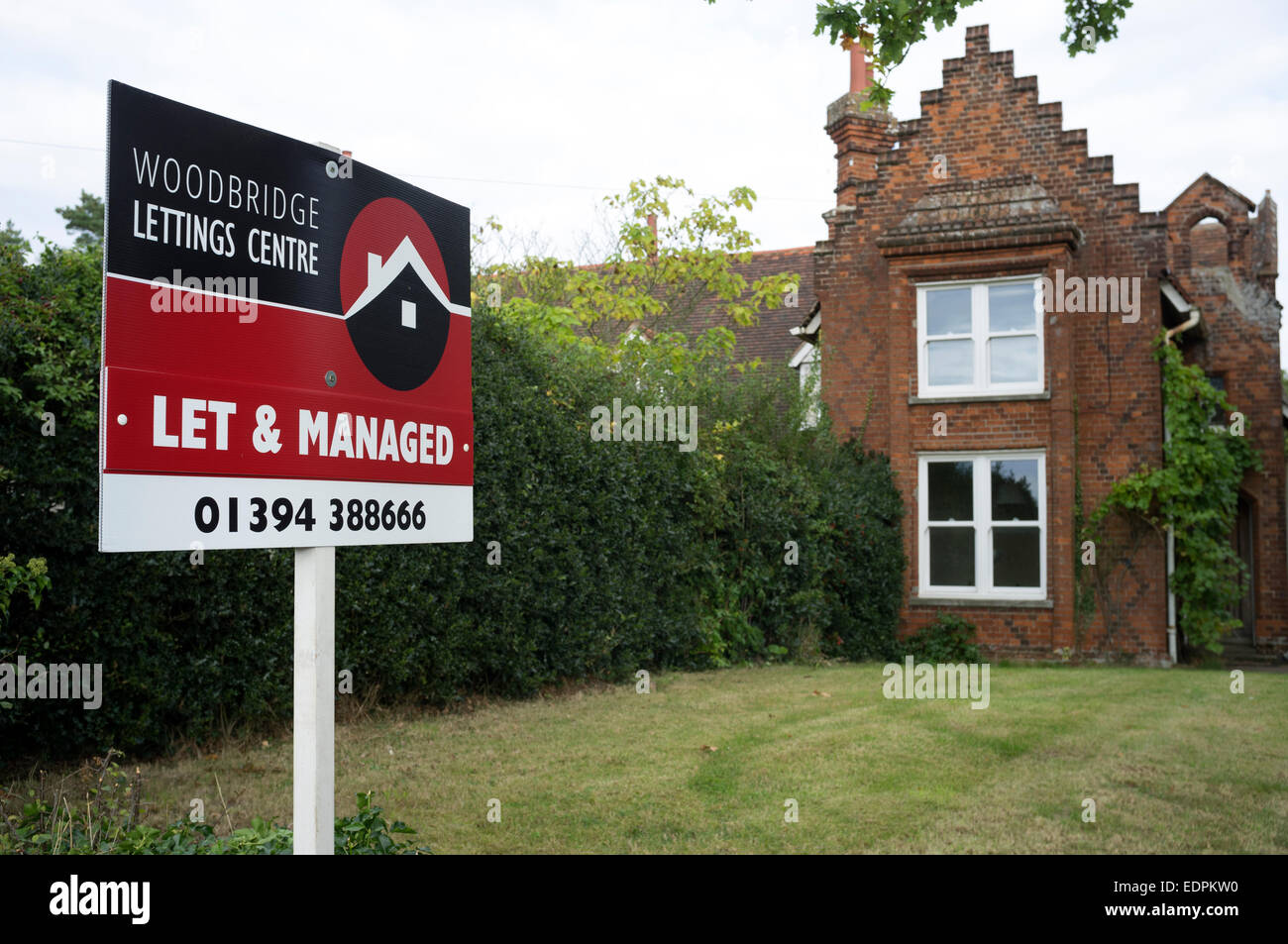 Lettings board outside a house in the village of Sutton, Suffolk, UK. - Stock Image