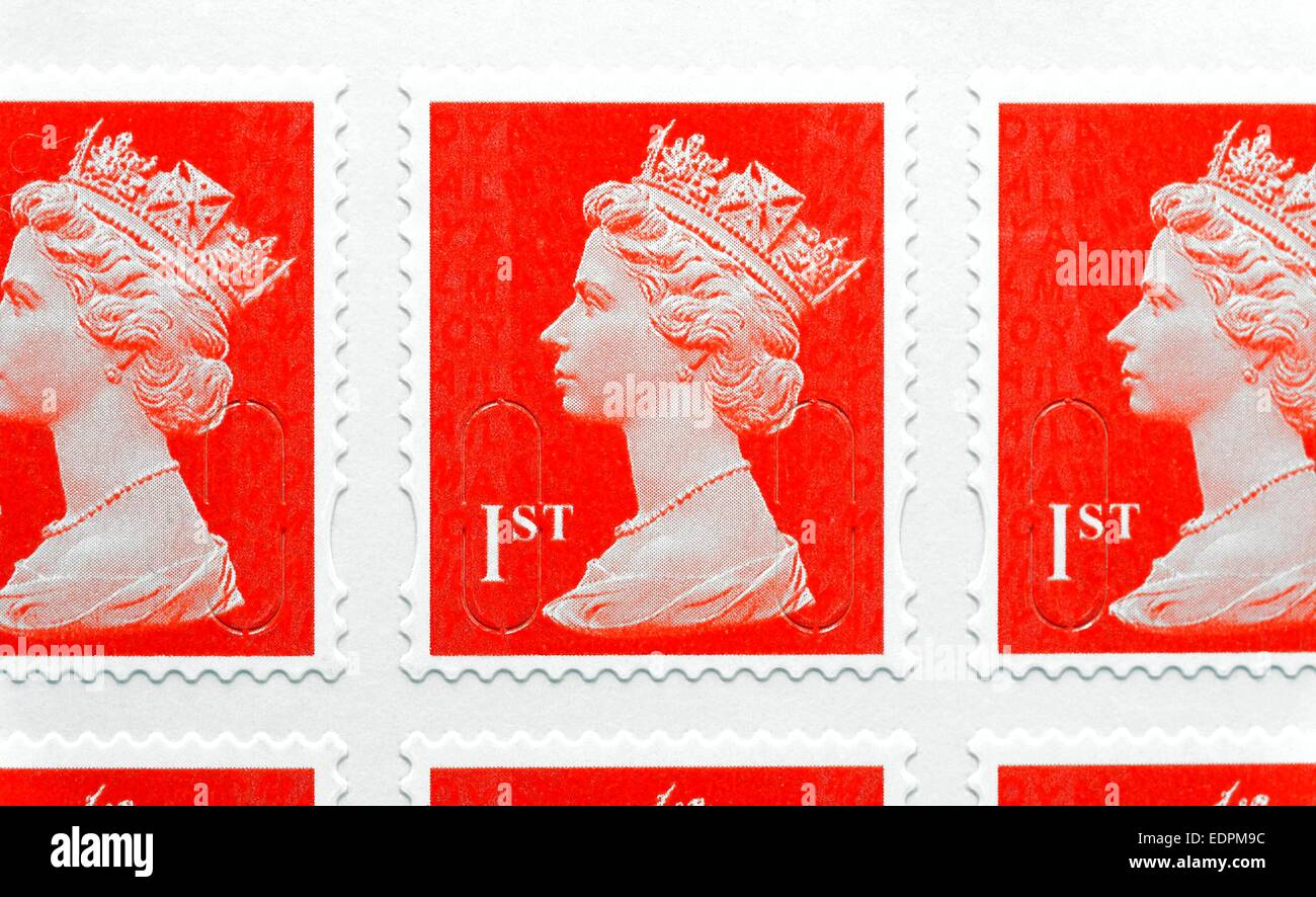 Red British first class royal mail postage stamps Stock Photo