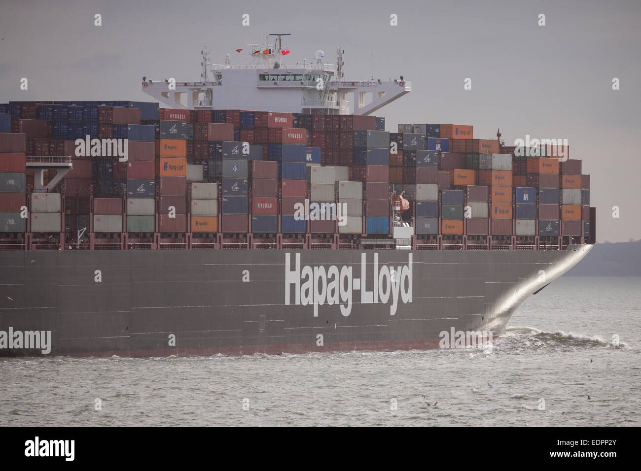 The Hapag-Lloyds cargo ship, Essen Express departing Southampton. - Stock Image