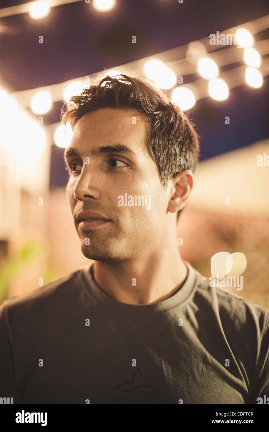 A portrait of a young man in the evening. Stock Photo