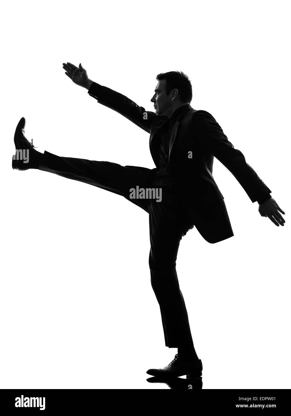 one caucasian extreme right wing man marching in silhouette on white background - Stock Image