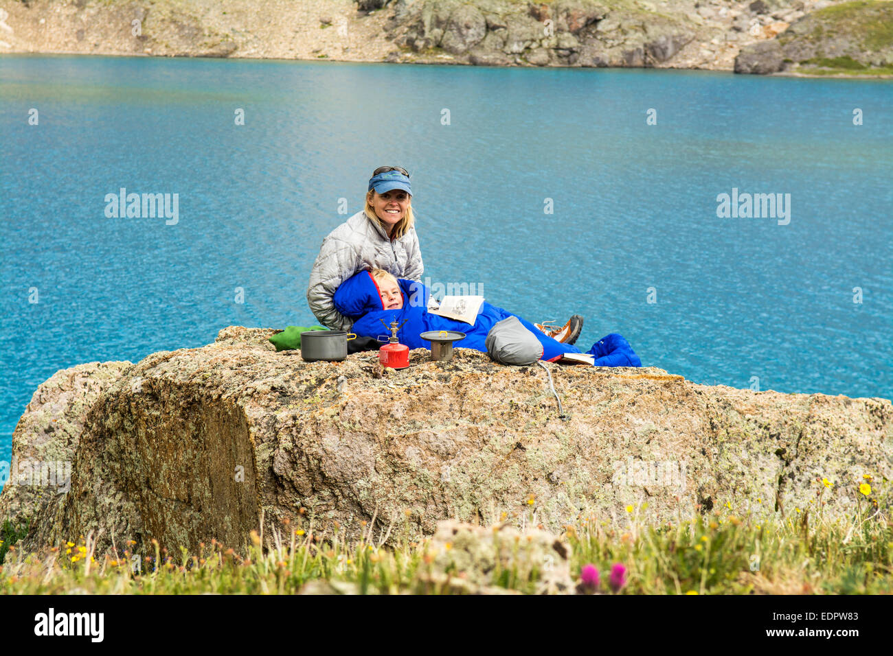 A woman and her daughter camping near blue lake, San Juan National Forest,  Silverton, Colorado. - Stock Image