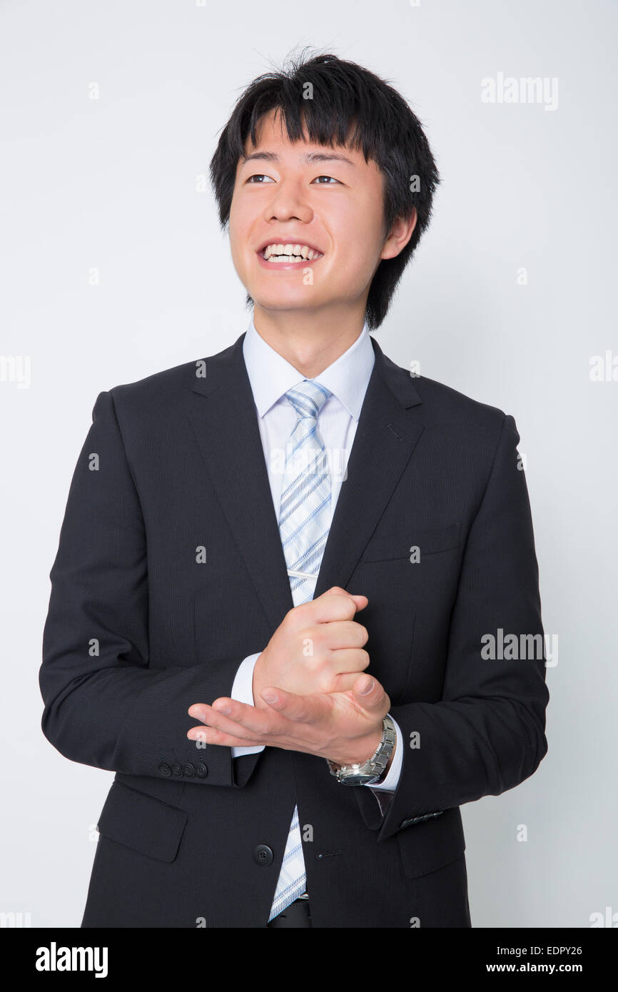 Businessma Pounding Fist into Palm of His Hand and Looking up - Stock Image
