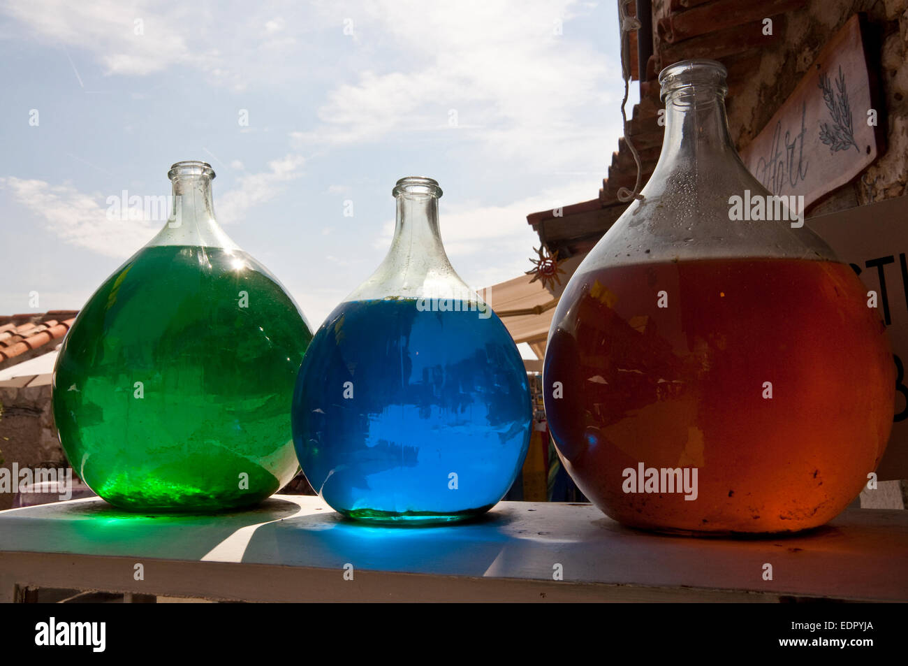 Perfume factory outlet in Grasse, France with red, green, blue backlit essence bottles - Stock Image